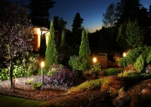 Home garden evening illumination electric lights on garden patio