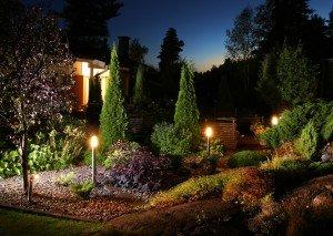 Home garden evening illumination electric lights on garden patio